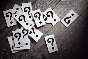 Question mark cards on wooden table