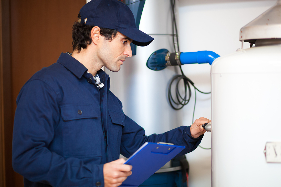 Technician diagnosing problems with a water heater